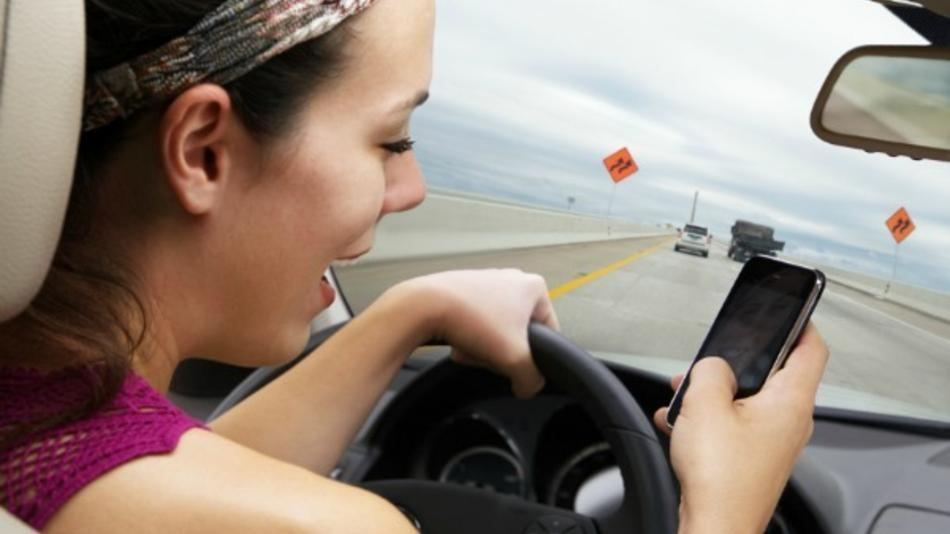 A driver browsing social networks while at the wheel.