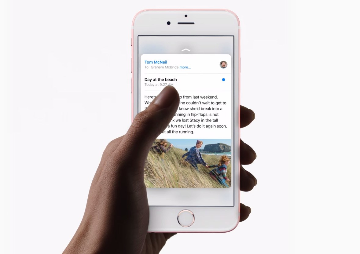 A hand demonstrating 3D touch on the iPhone 6s